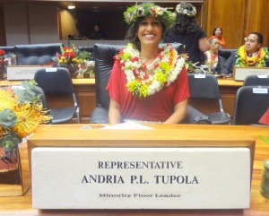 Rep Tupola at desk Chamber